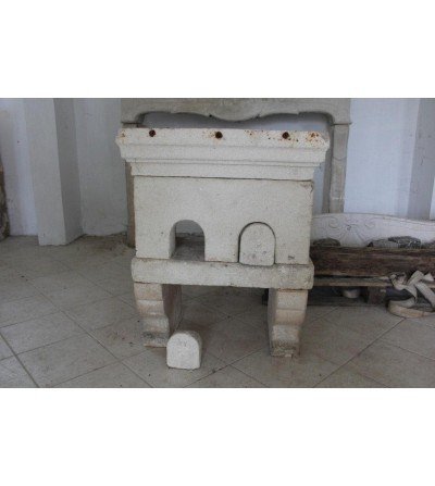Ancient kitchen fireplace in stone